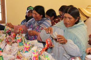 Remplissage des offrandes par les femmes des mineurs